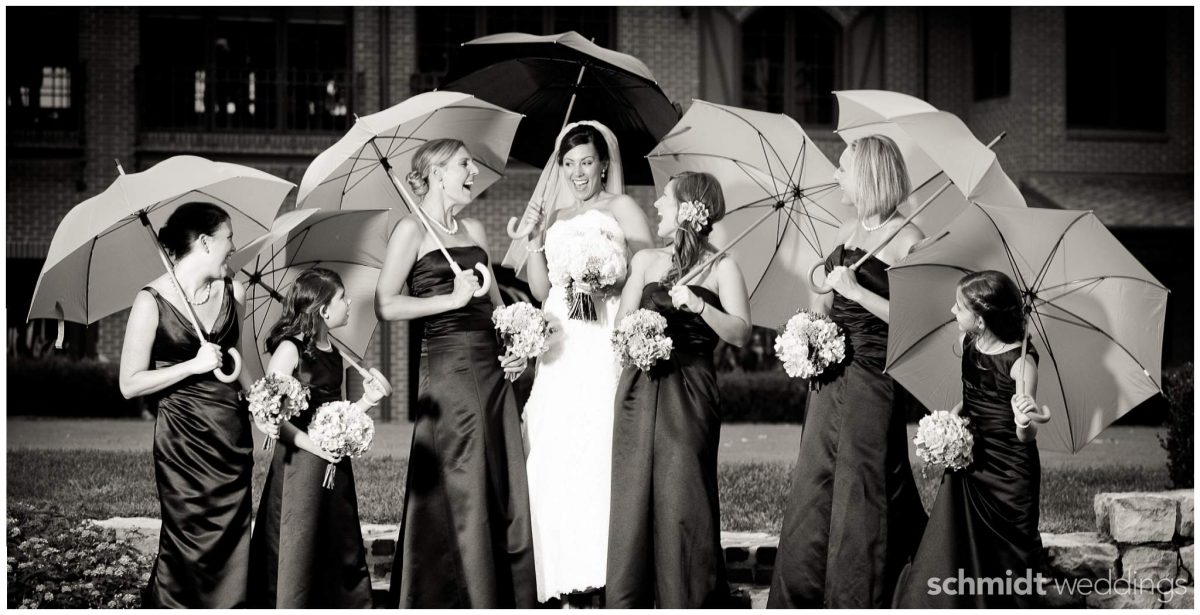 Bridesmaids group picture ideas with umbrellas Schmidt weddings Chicago